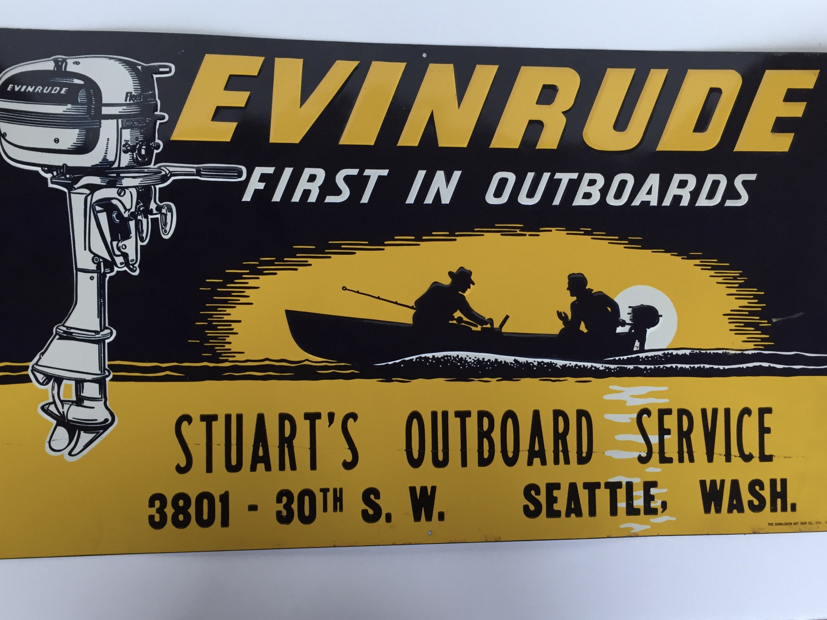 yellow Evinrude sign